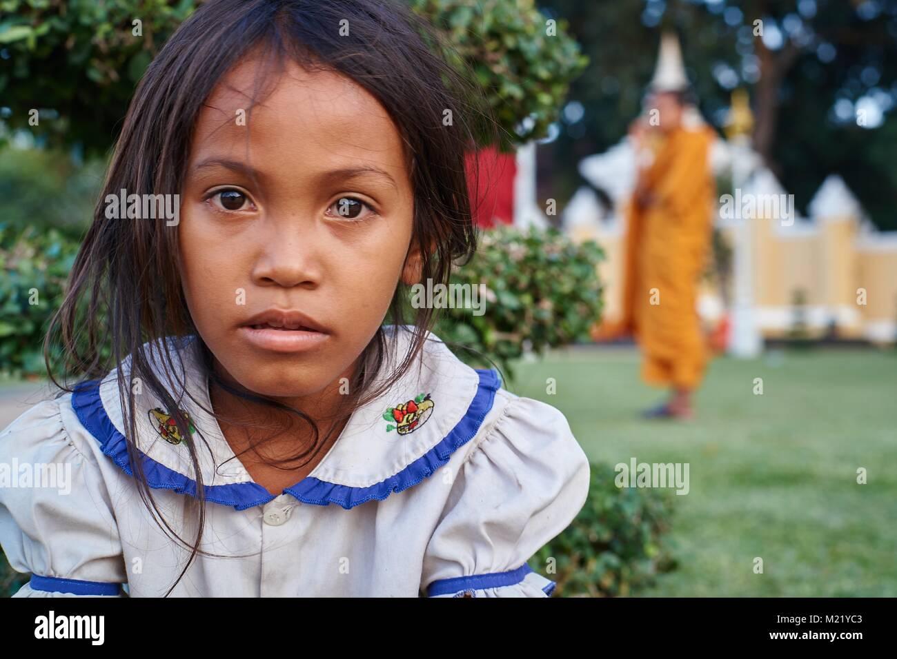 Little girl playing  of Royal Palace, Phnom Penh, Cambodia - Stock Image