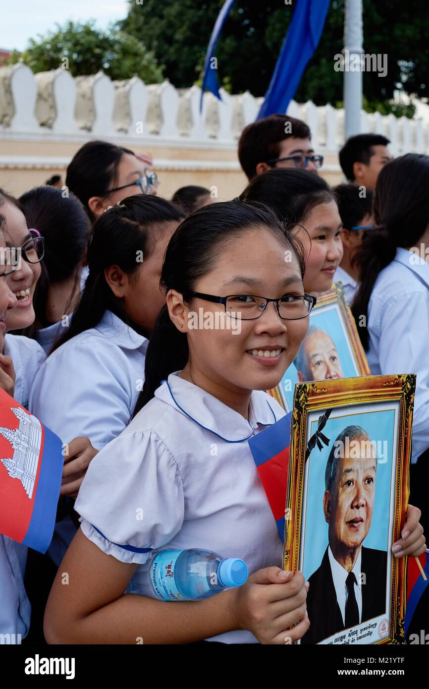 Schoolgirl cheering for Cambodian King, Royal Palace, Phnom Penh, Cambodia Stock Photo
