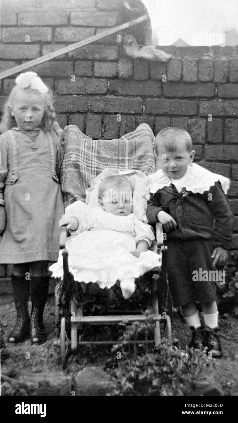 Three children photographed in the Edwardian era, Brampton Chesterfield Derbyshire England UK - Stock Image