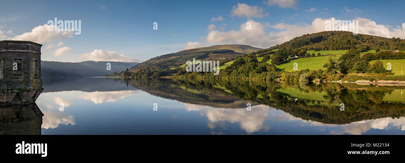 A panoramic shot of Talybont Reservoir captured on a bright Autumn morning. - Stock Image