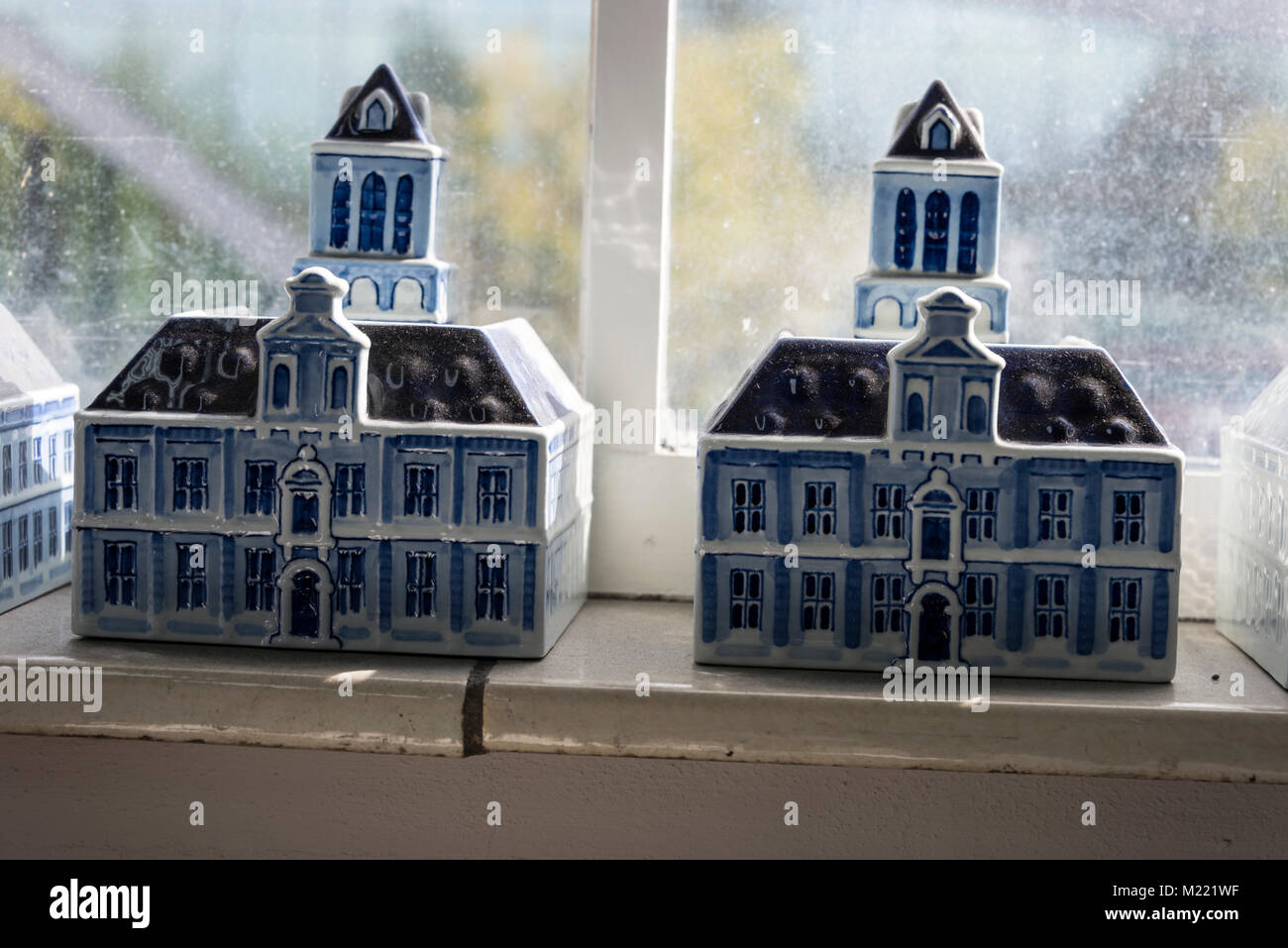 A couple of Royal Delft earthenware models of Delft Town Hall at the Royal Delft factory in Delft, Holland - Stock Image