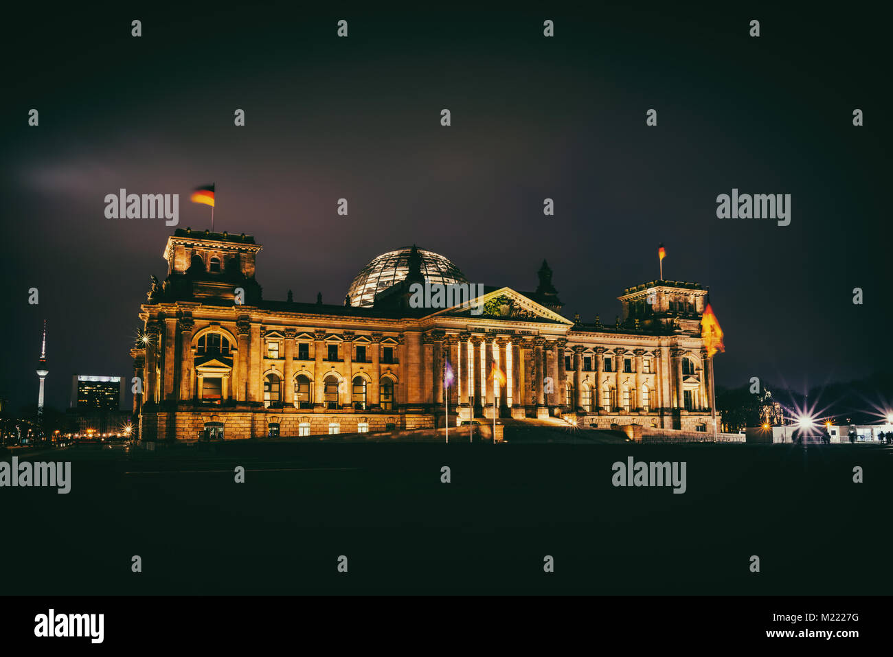 Illuminated Reichstag building at night in Berlin, Germany - Stock Image