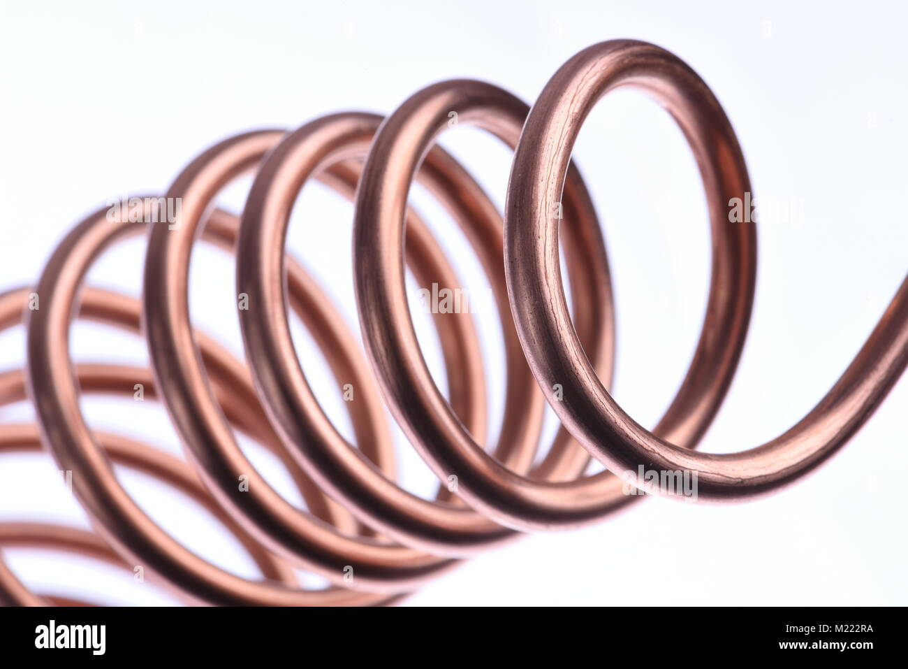 Copper wire close-up isolated on white background - Stock Image