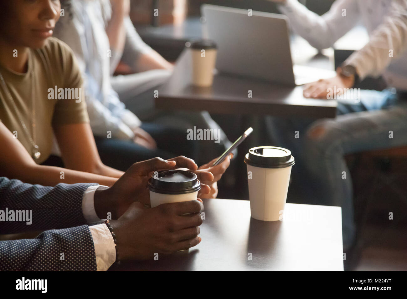 Coffee break in cafe with modern gadgets concept, closeup view - Stock Image