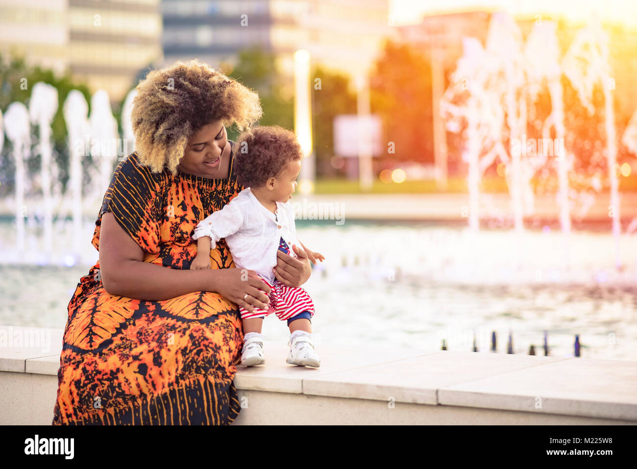 Baby daughter's first steps - Stock Image