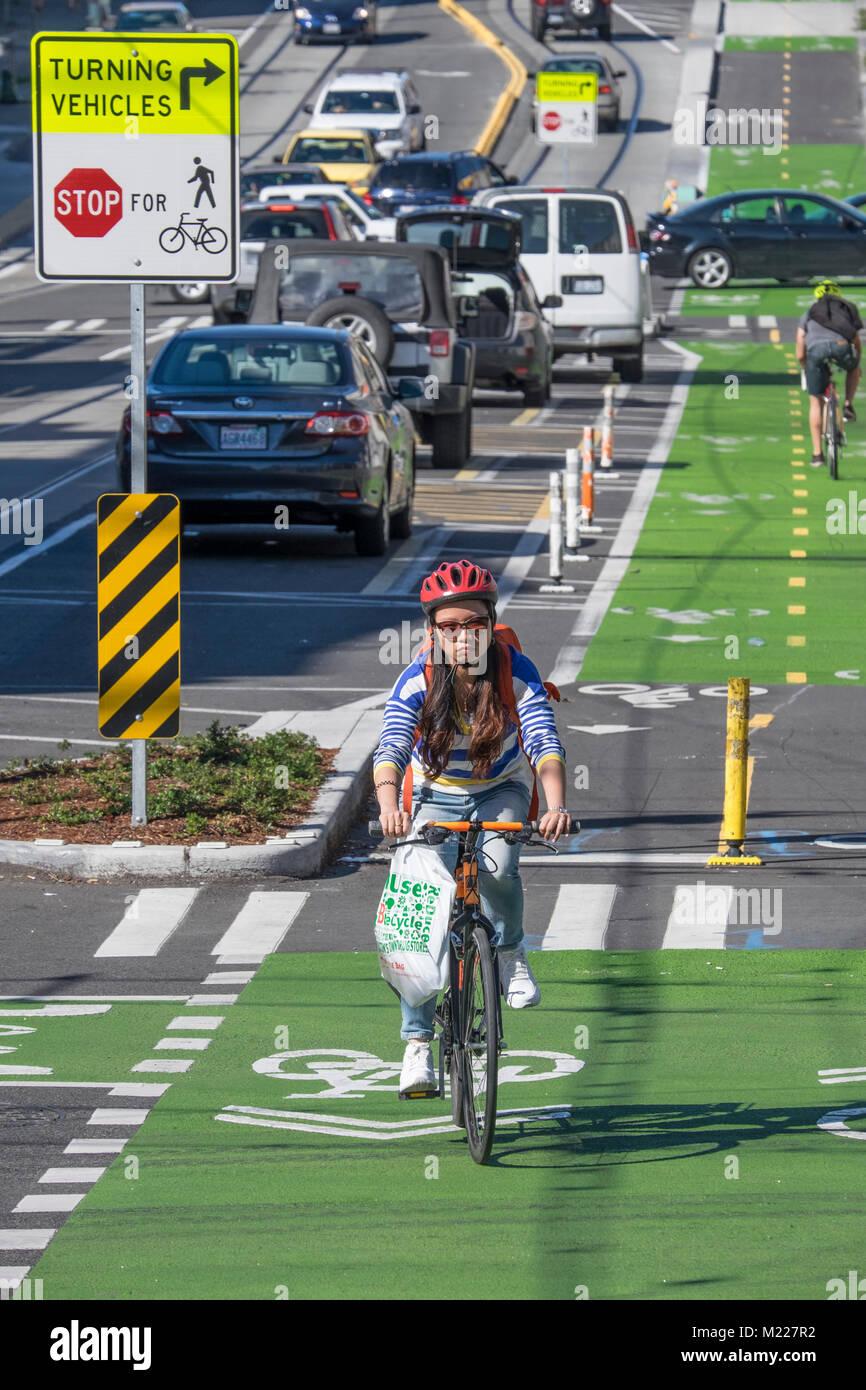 United States, Washington, Seattle, Bicyclists using bike lane on Broadway - Stock Image
