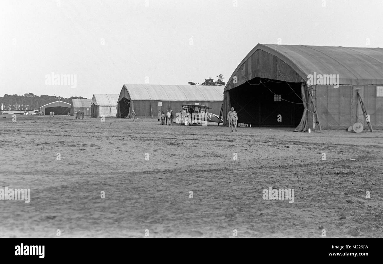 World War 1 era photograph taken at Bergeus Aerodrome in France. A Spad aircraft can be seen being repaired between - Stock Image