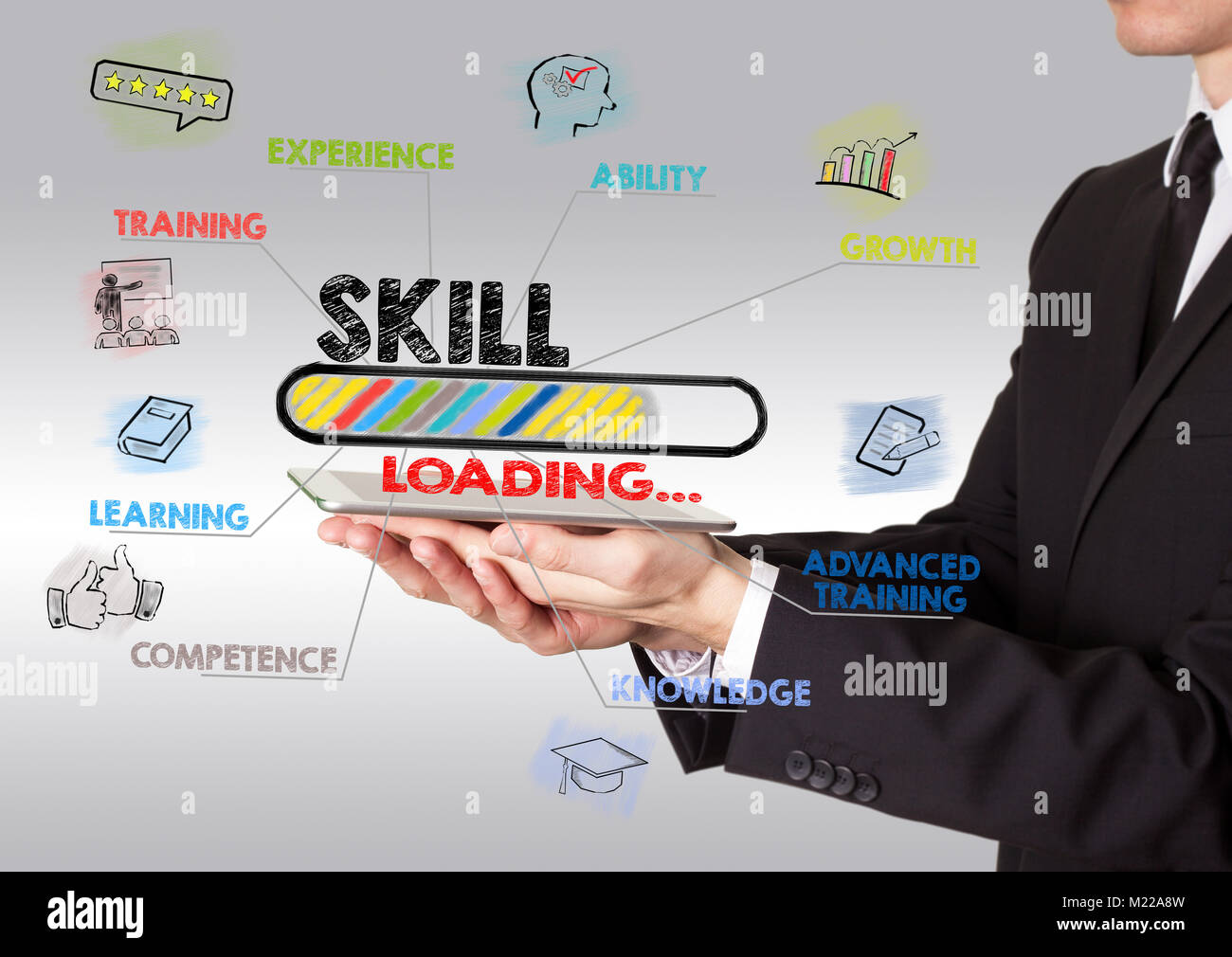 skill concept, young man holding a tablet computer - Stock Image