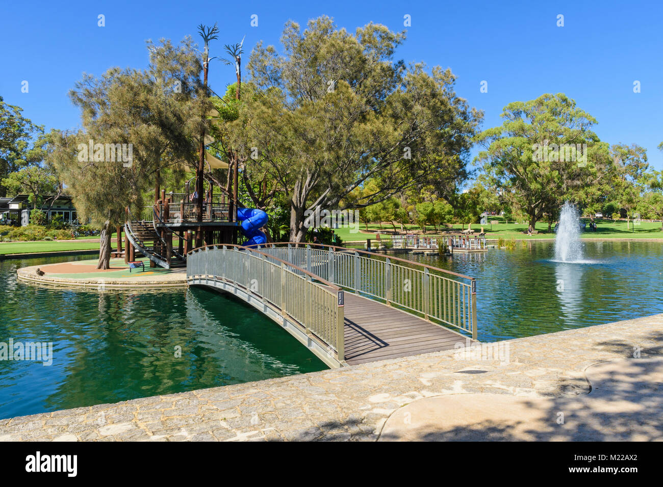 Bridge over to Lycopod Island in the pond at May Drive Parkland playground, Kings Park, Perth, Western Australia - Stock Image