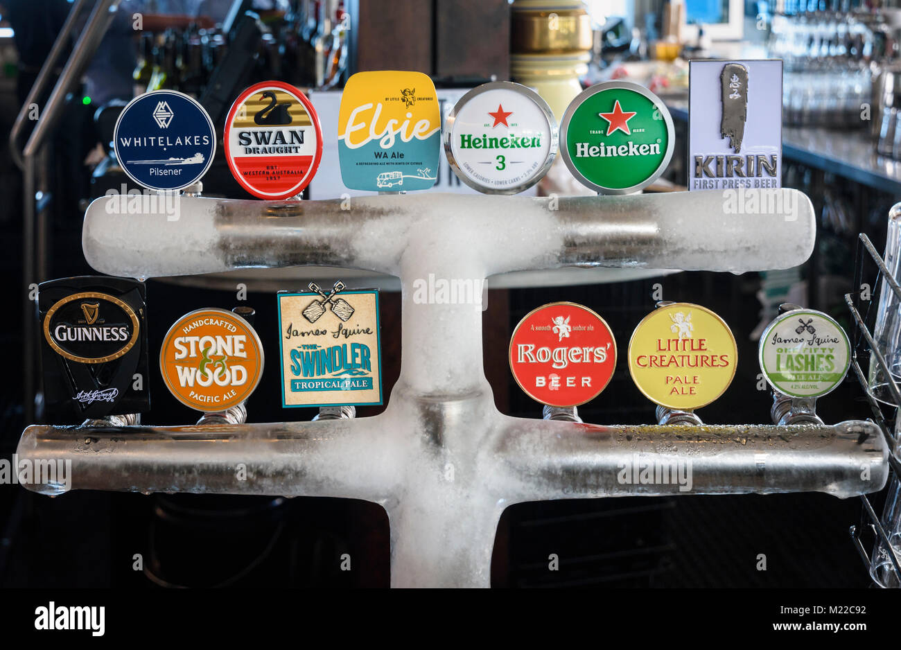 Selective focus on a variety of beer taps - Stock Image
