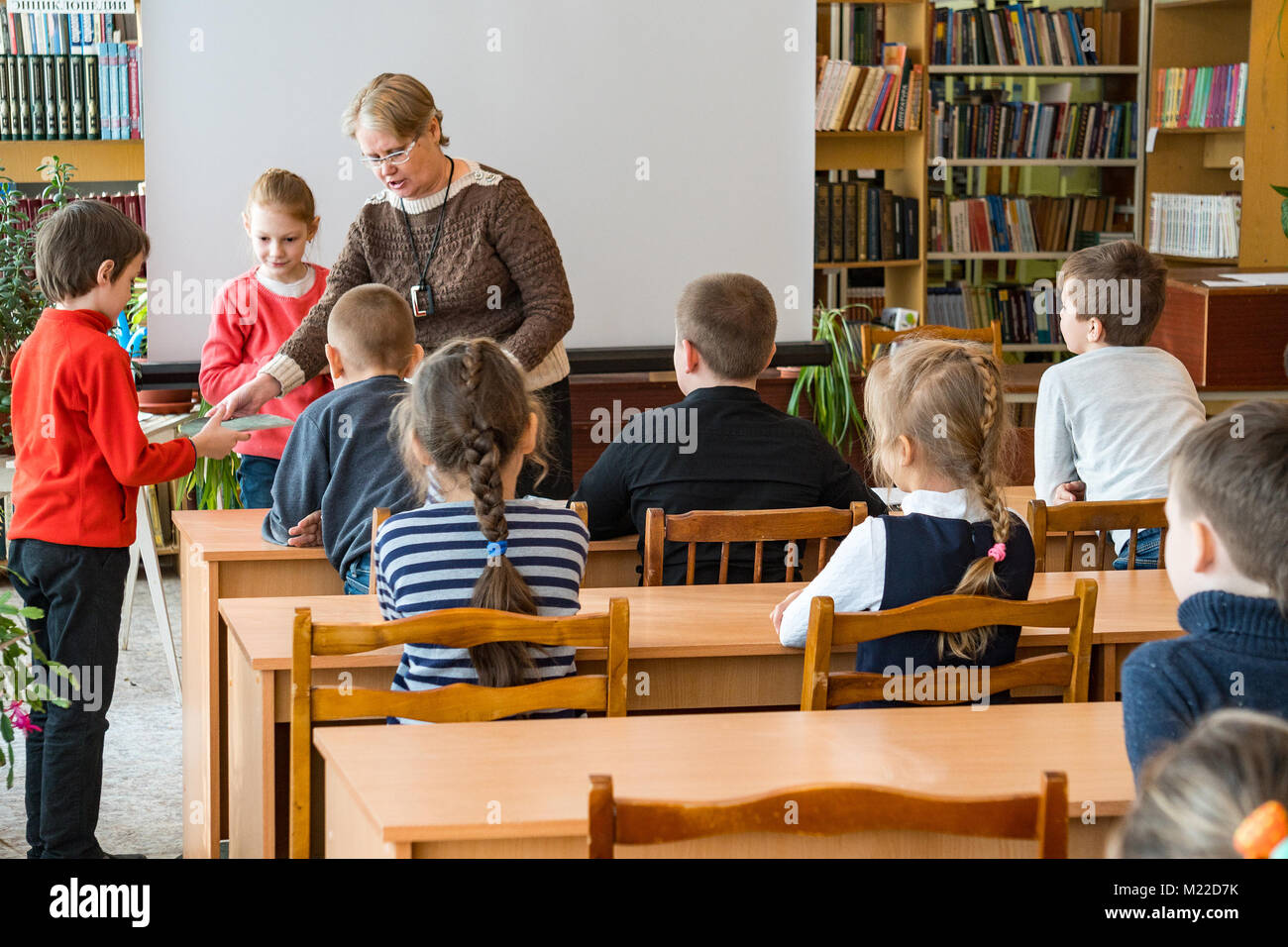 CHAPAEVSK, SAMARA REGION, RUSSIA - JANUARY 31, 2018: School kids of elementary school in the classroom with a female - Stock Image