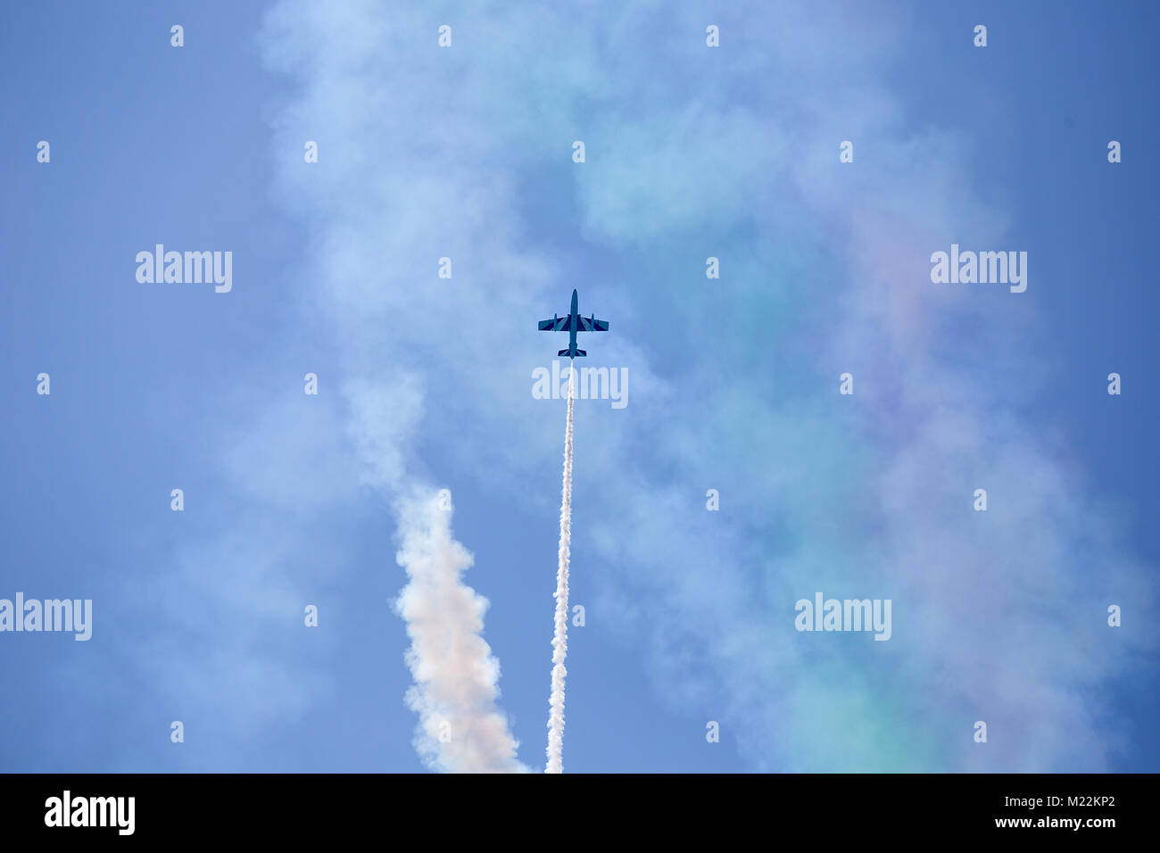 Flight of reactive plane with lot of white smoke - airshow exhibition of solo pilot Italian acrobatic aircraft team - Stock Image