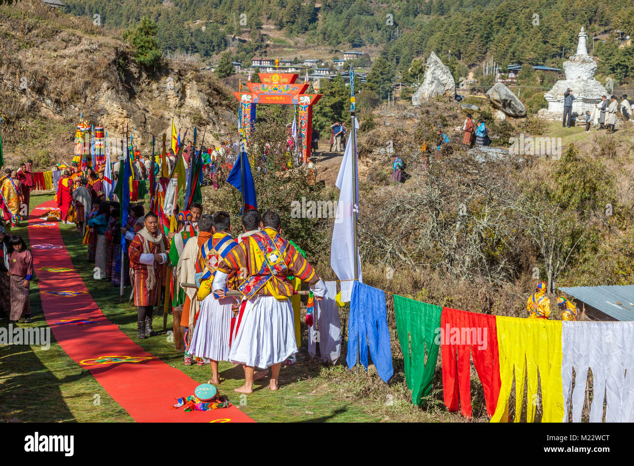 Prakhar Lhakhang, Bumthang, Bhutan.  People Waiting on  Pathway Leading to the Monastery, Waiting for King's - Stock Image