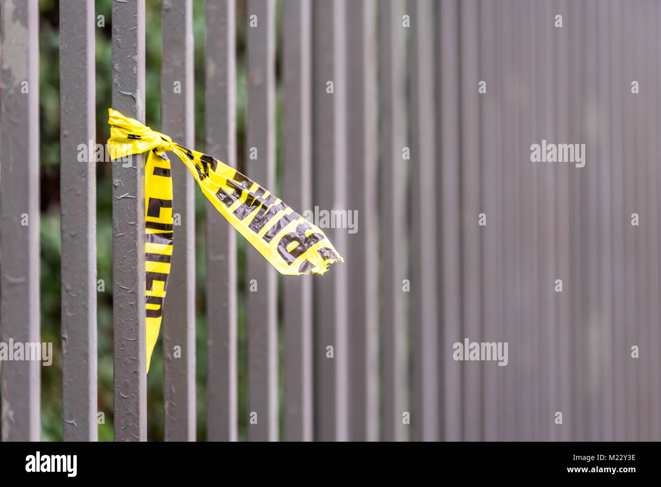 Crime scene border tape peace left on fence in UK - Stock Image