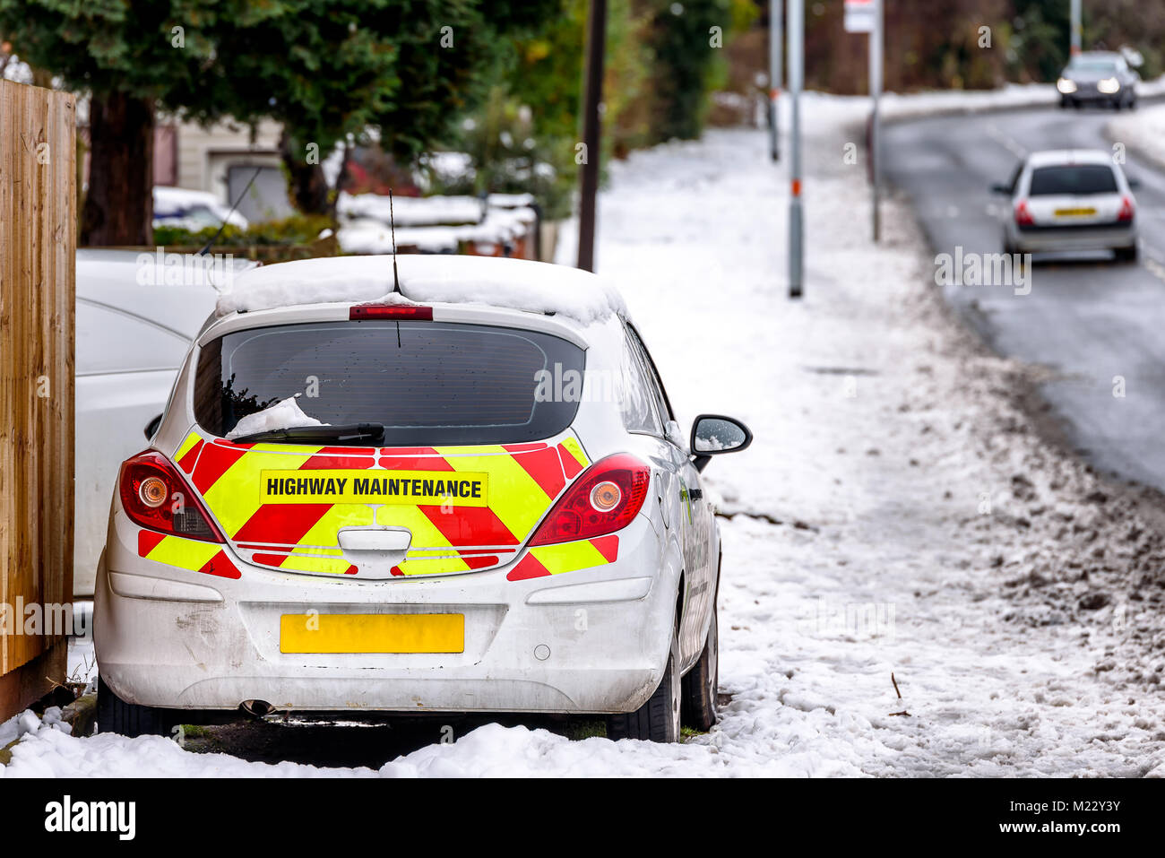 Day view UK Motorway Highway Maintenance car parked on snowy road Stock Photo