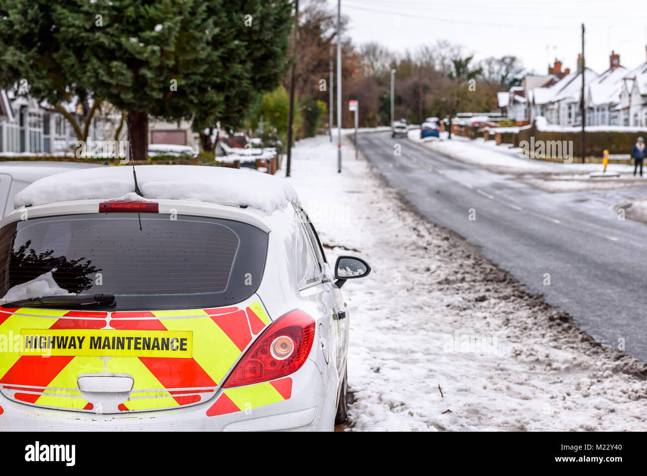 Day view UK Motorway Highway Maintenance car parked on snowy road - Stock Image