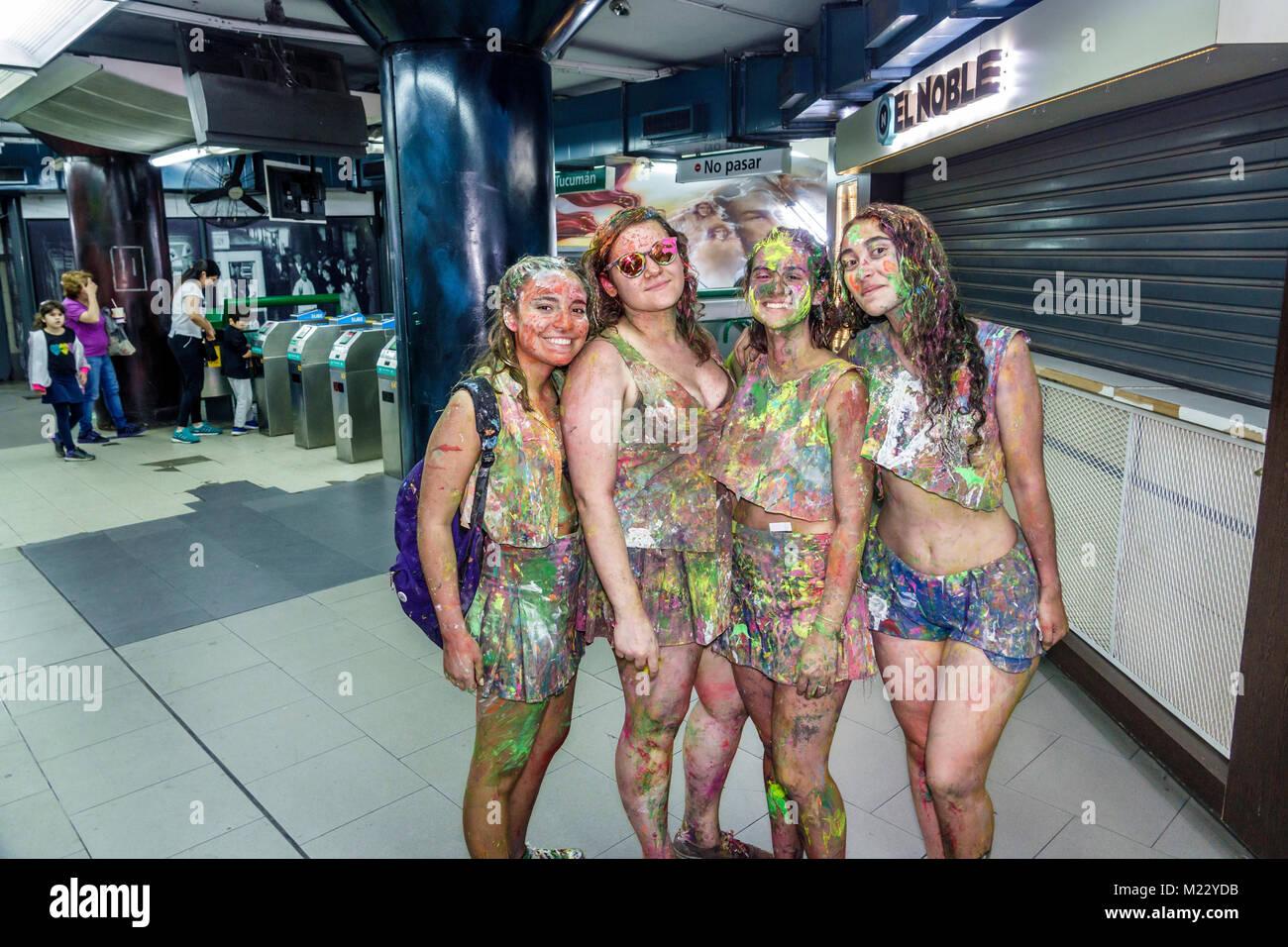 Buenos Aires Argentina Subte subway public transportation Tribunales station teen girl student friends splattered - Stock Image
