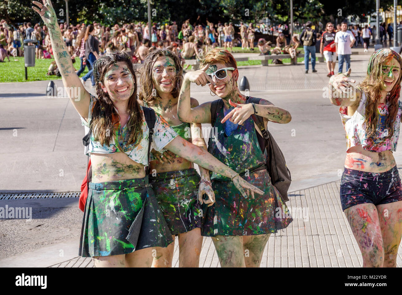 Buenos Aires Argentina Plaza Lavalle park teen girl student friends splattered body paint high school graduation - Stock Image