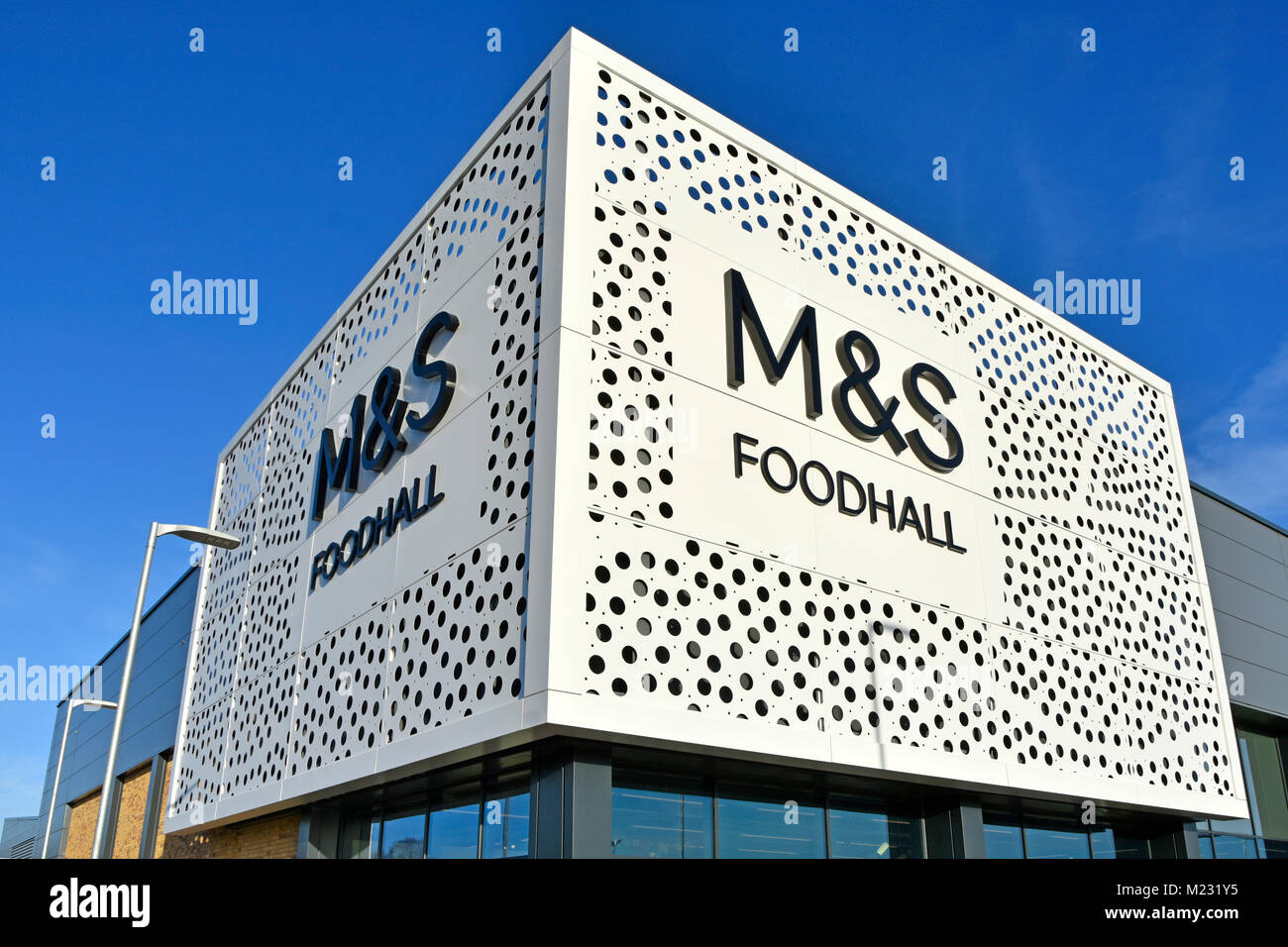 Modern dots design of front fascia & sign new M&S foodhall modern store building on corner site retail park - Stock Image