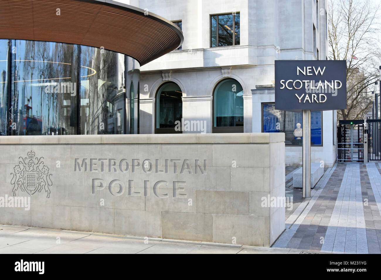 Metropolitan Police Sign U0026 Coat Of Arms Engraved On Stone Wall At New  Scotland Yard Revolving Sign Outside Relocated HQ Victoria Embankment  London UK