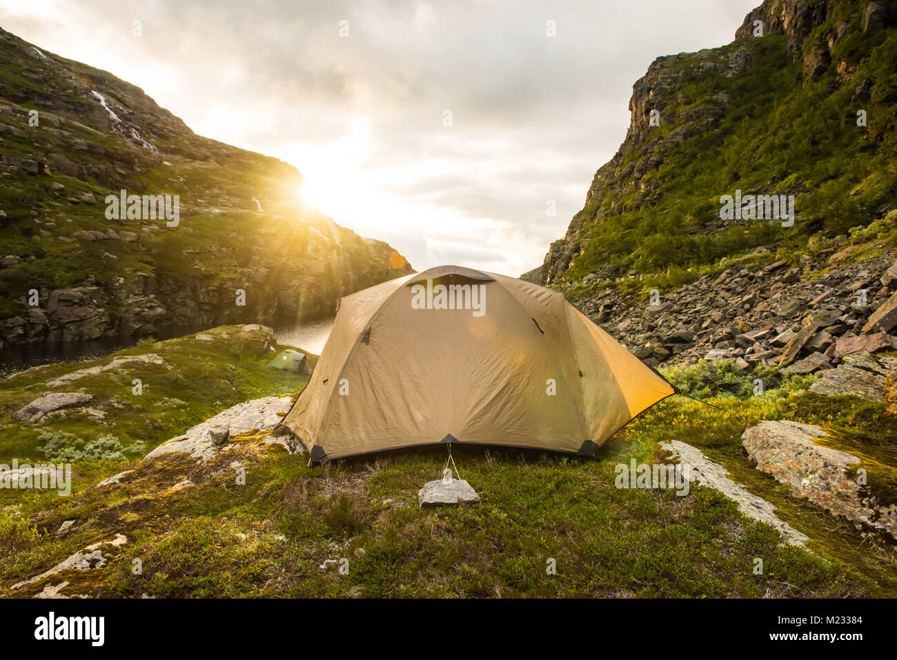 tourist tent in mountains summertime sunset Norway - Stock Image