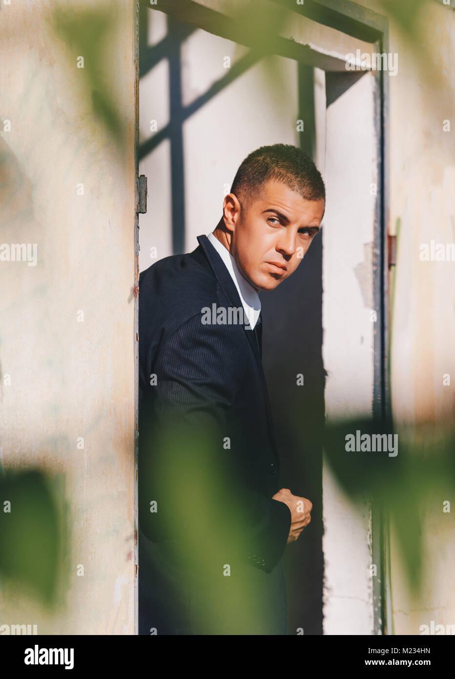 Handsome man in black suit and sunglasses. Secret agent, mafia, bodyguard concept. - Stock Image