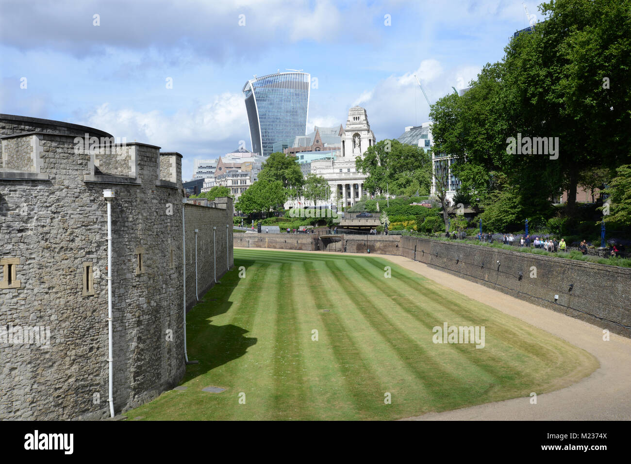 View of the city from the moat of Tower of London with Trinity Hill Memorial - Stock Image