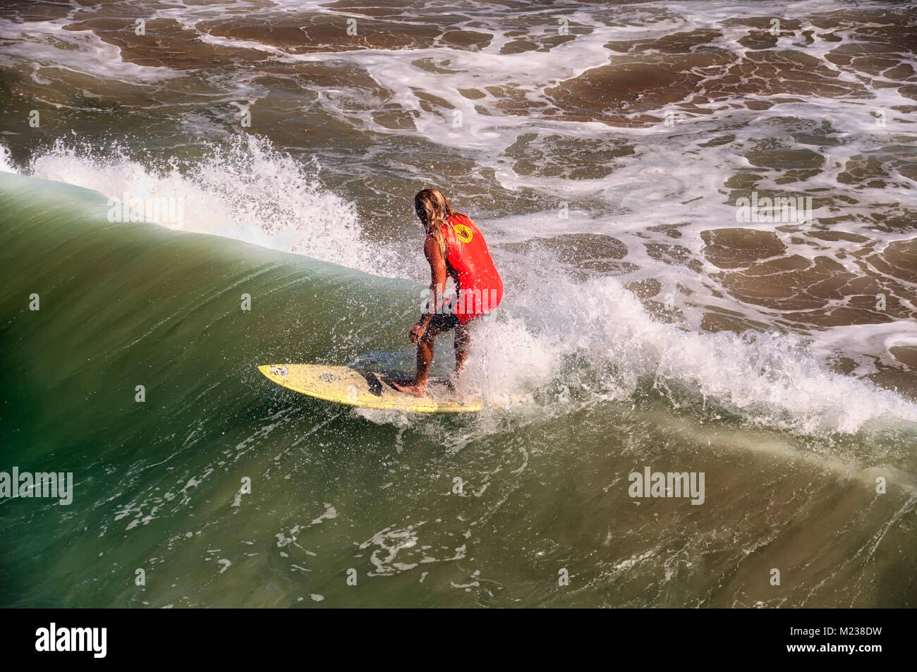 September 30, 2016.  Manhattan Beach, California. A surfer riding the waves at manhattan beach california on the - Stock Image