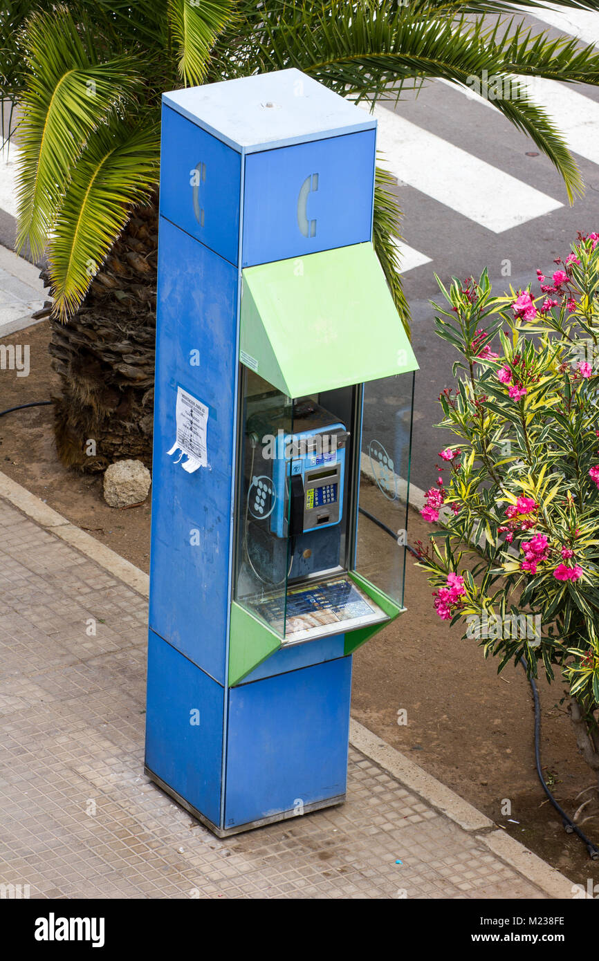 Spanish Telefonica public pay phone box on a pavement in Los Cristianos, Tenerife 2016 - Stock Image