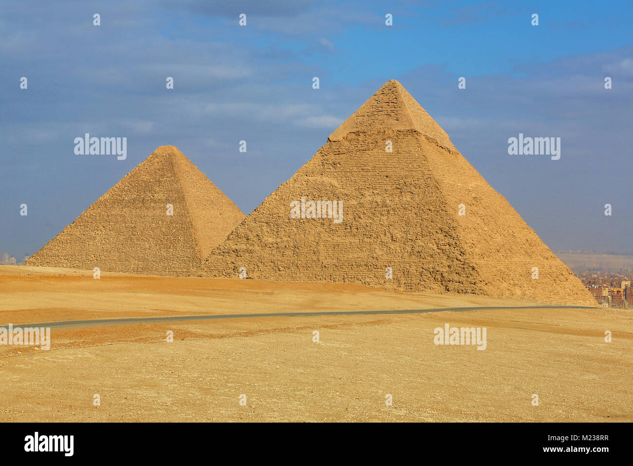 The Great Pyramid of Khufu (or Cheops)  and the Pyramid of Khafre (or Chephren) on the Giza Plateau, Cairo, Egypt - Stock Image