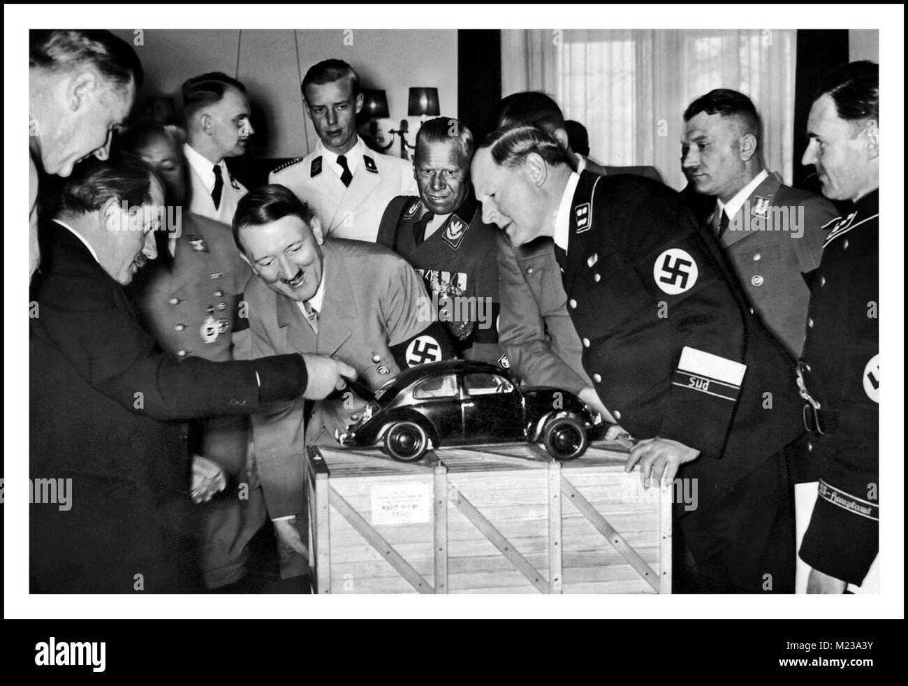 1930's Dr Porsche showing Adolf Hitler a scale model of his unique air cooled engine and inspired design... 'the - Stock Image