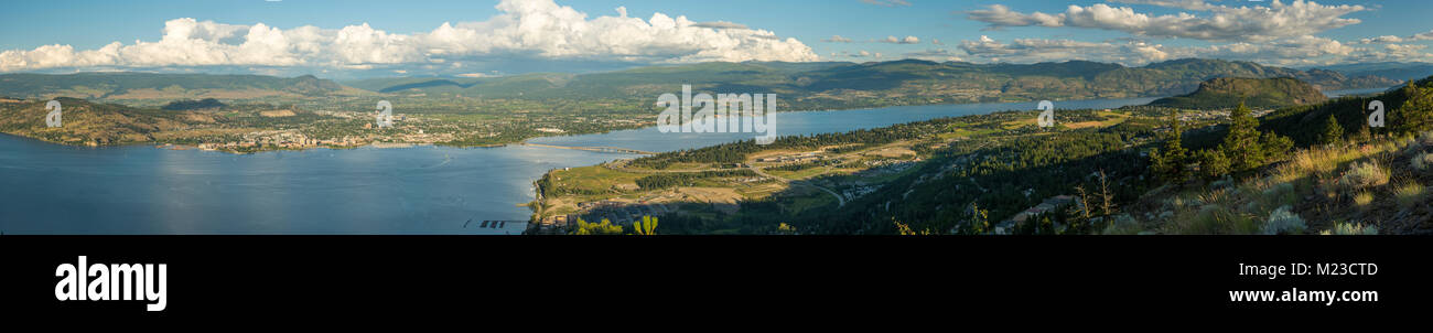British Columbia, Canada.  Panoramic view of the city of Kelowna, and Okanagan Lake and Valley in summer as viewed from West Kelowna. Stock Photo