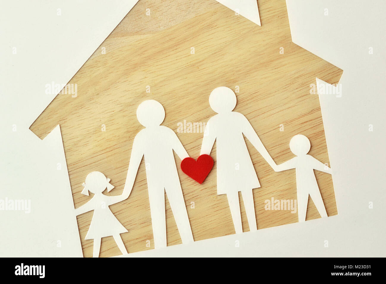 Paper family cut-out and house - Love and family union concept Stock Photo