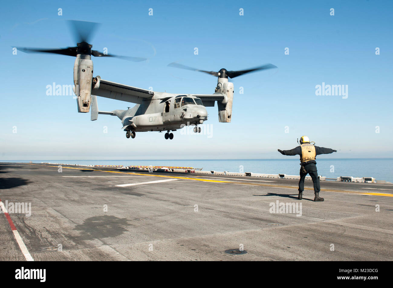 180201-N-ZS023-007  PACIFIC OCEAN (Feb. 1, 2018) An MV-22 Osprey helicopter assigned to Marine Medium Tiltrotor Squadron (VMM) 161 (Reinforced) aboard the amphibious assault ship USS America (LHA 6) lands on the flight deck. America, part of the America Amphibious Ready Group, with embarked 15th Marine Expeditionary Unit (MEU), is returning from a 7-month deployment to the U.S. 3rd, 5th and 7th fleet areas of operations. (U.S. Navy photo by Mass Communication Specialist 3rd Class Vance Hand/Released) Stock Photo