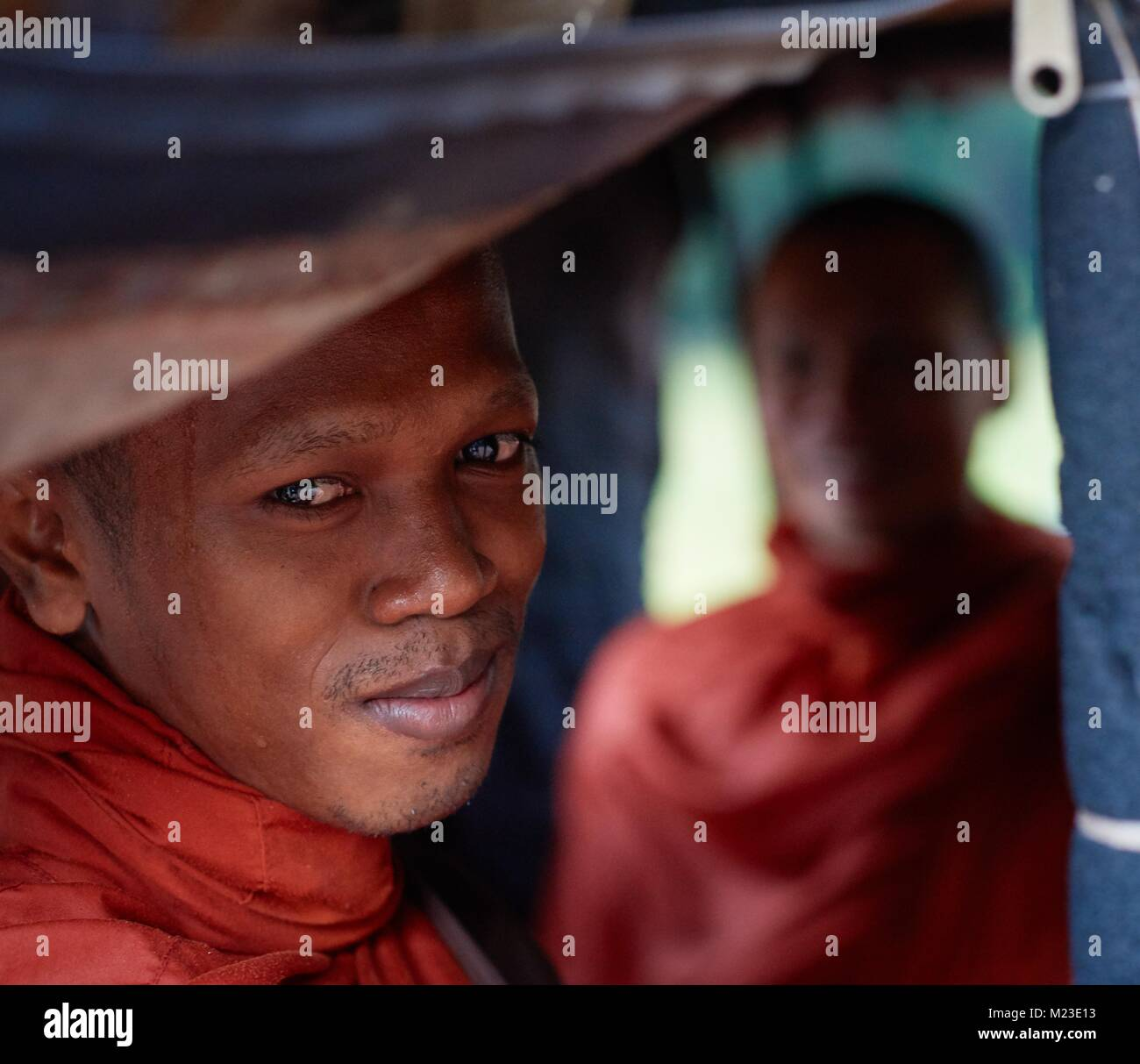 Monk sitting in tuk-tuk, Angkor, Cambodia - Stock Image