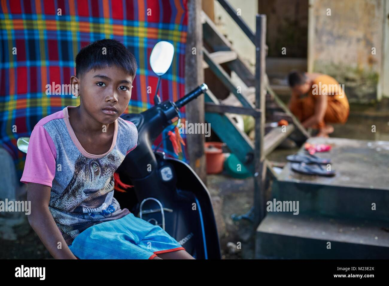 Camboadian boy and little Buddhist Monk in buddhist monestry, Battambang, Cambodia - Stock Image