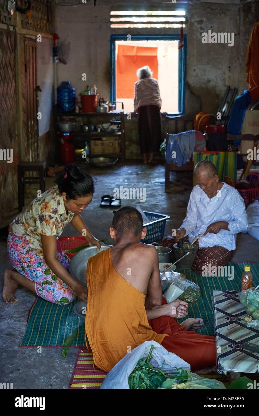 Cooking in a monestry living room, Battambang, Cambodia - Stock Image