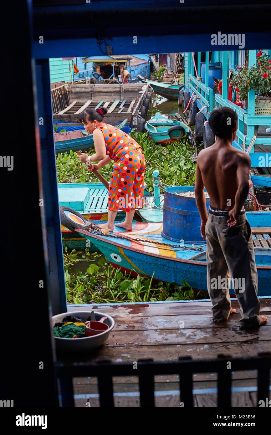 Man in floating house, Kompong Luong, Cambodia - Stock Image