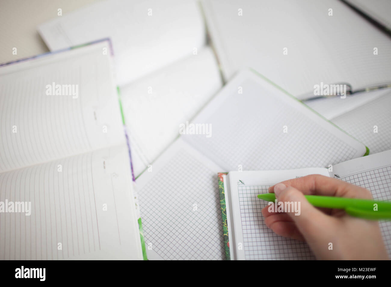 A large number of diaries and notebooks in the clear. Background - Stock Image