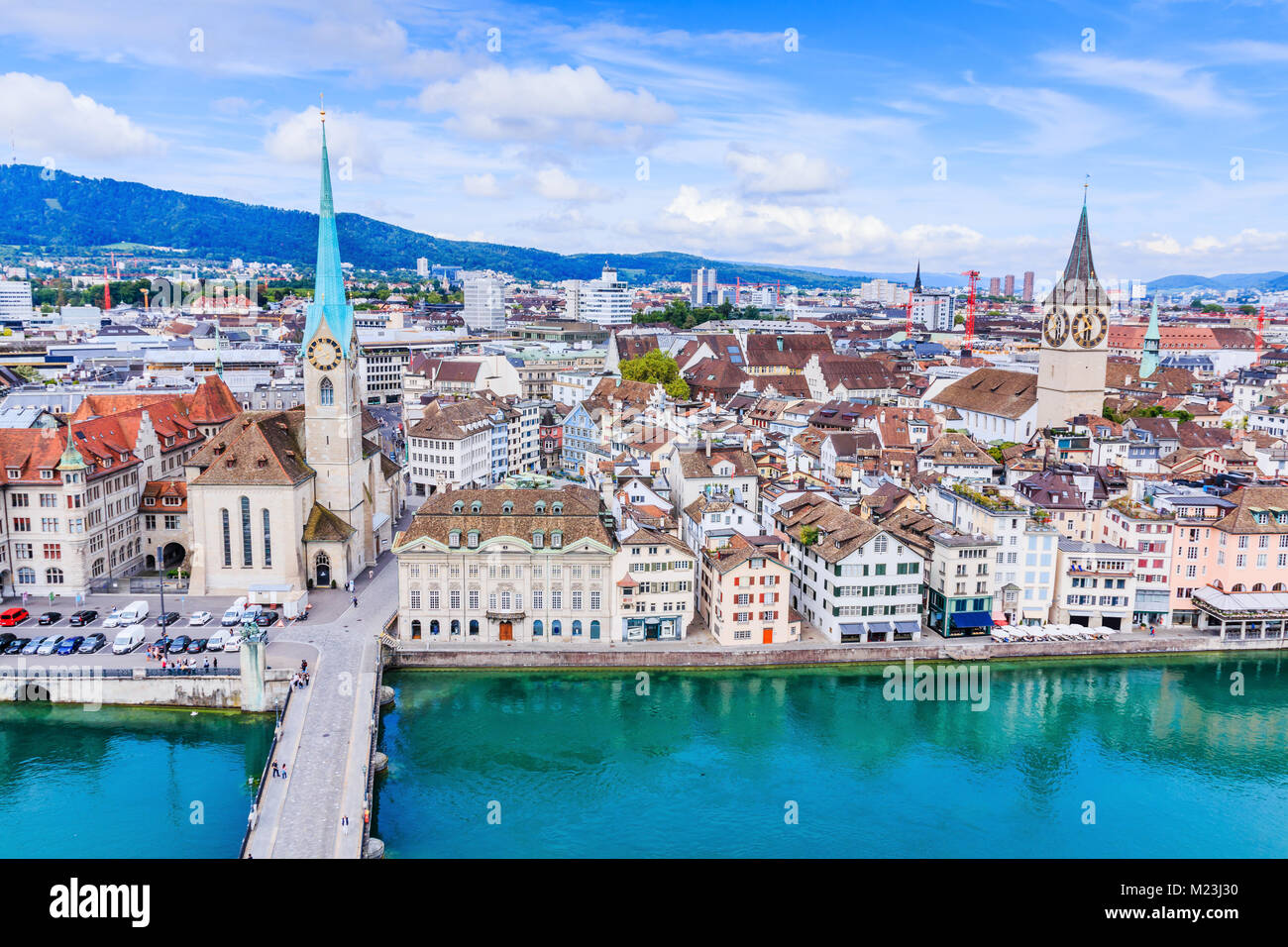 Zurich, Switzerland. View of historic Zurich city center with famous Fraumunster Church, Limmat river and Zurich - Stock Image
