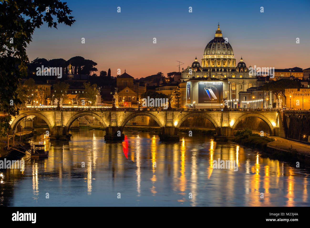 Vatican City and Saint Angelo Bridge at dusk, Italy - Stock Image