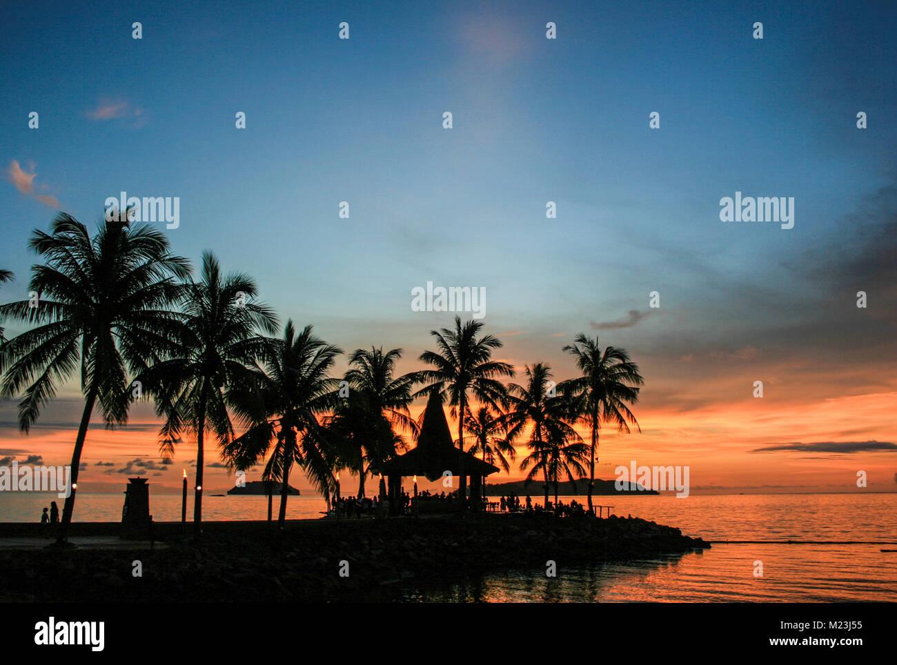 Sunset off Tanjung Aru, Kota Kinabalu, Sabah, Malaysia - Stock Image