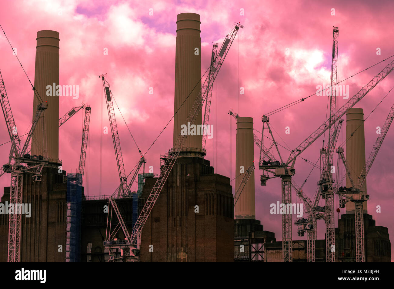 Redevelopment of Battersea Power Station in London with digitally colored sky - Stock Image