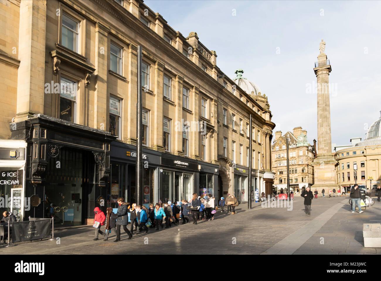 A group of schoolchildren walking down Grey Street, Newcastle, north east England, UK - Stock Image