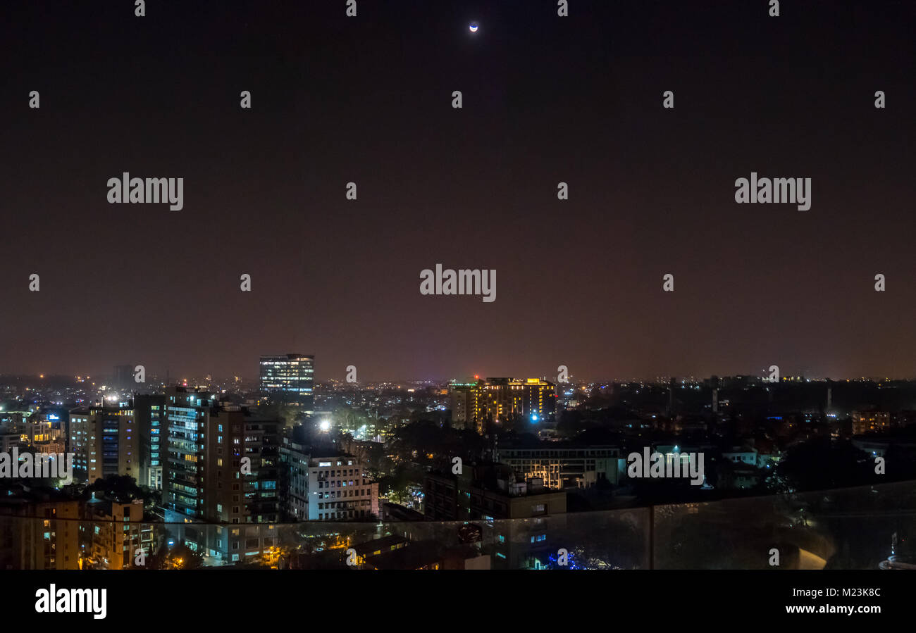 Half Moon Over Downtowm Bangalore Night Lights - Stock Image