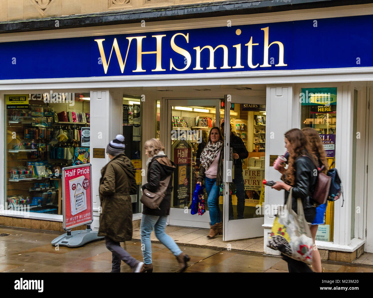 WHSmith newsagents shop front with people walking past on Cornmarket Street, Oxford, Oxfordshire, UK. Feb 2018 Stock Photo