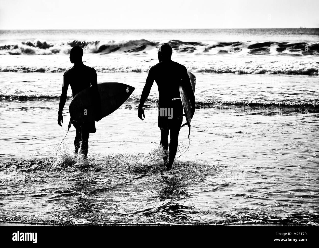 Surfers in Ghana - Stock Image