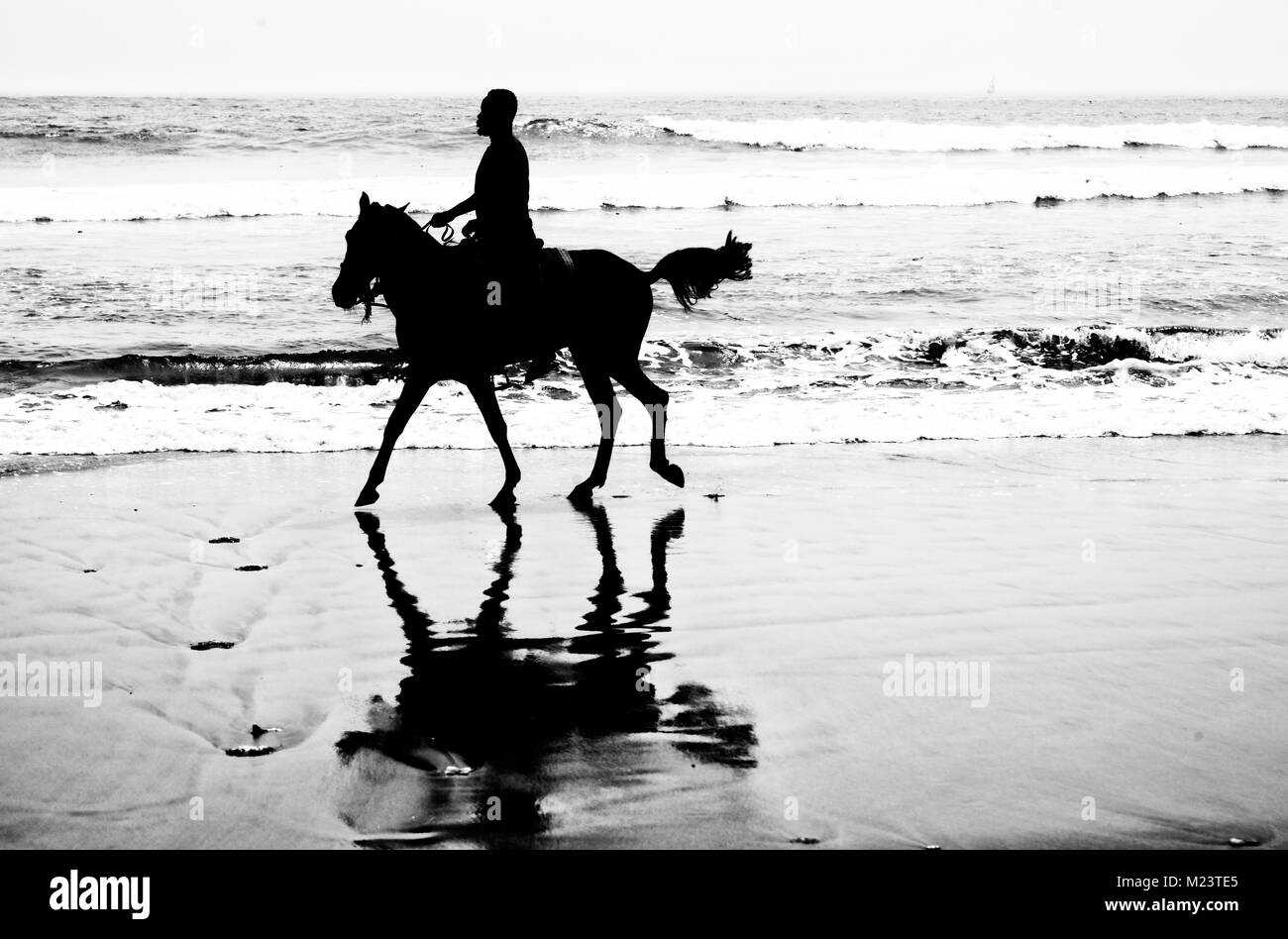 Horseback riding in Ghana - Stock Image