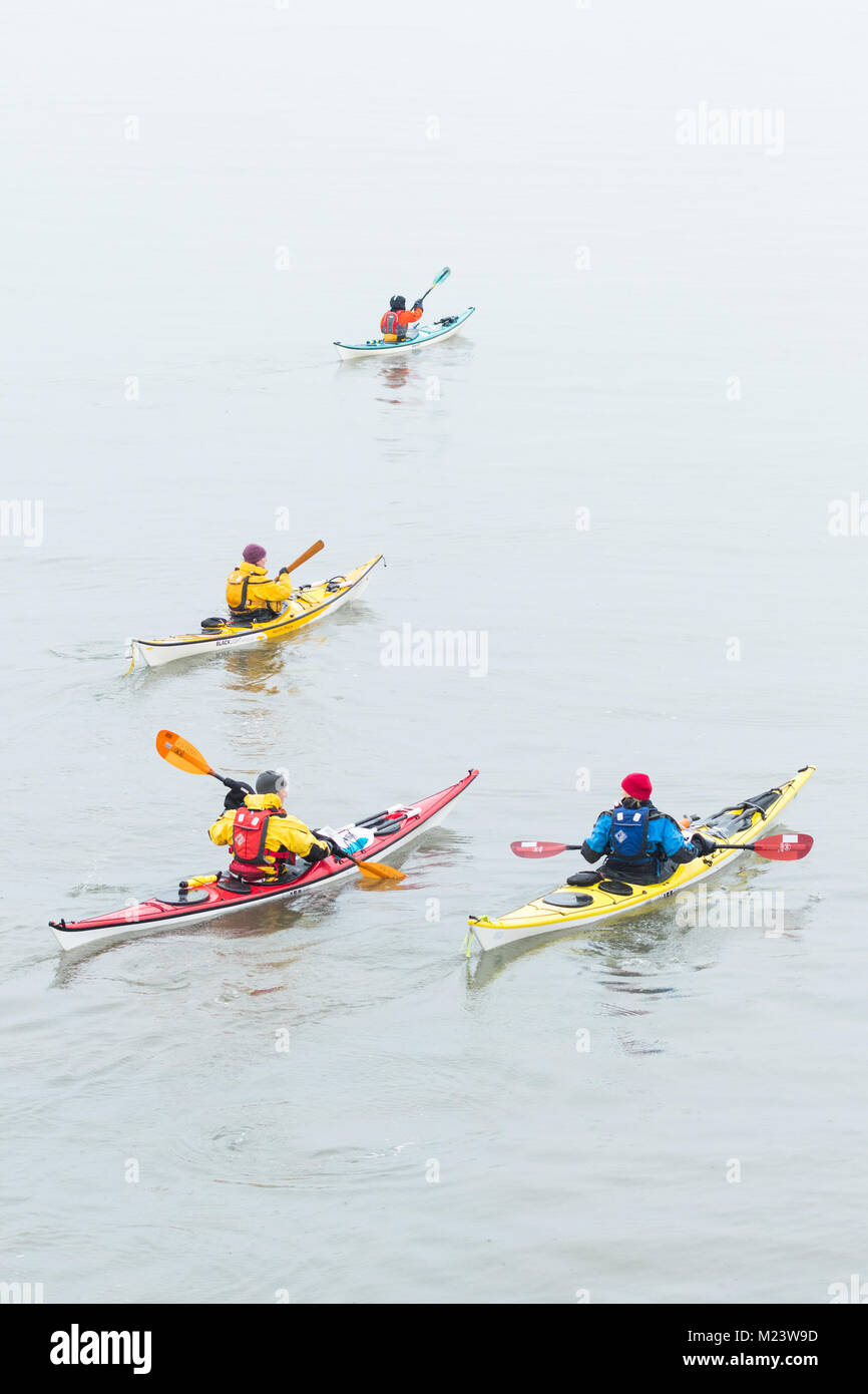 Sea kayaking in winter in Firth of Forth, Fife, Scotland, UK - Stock Image