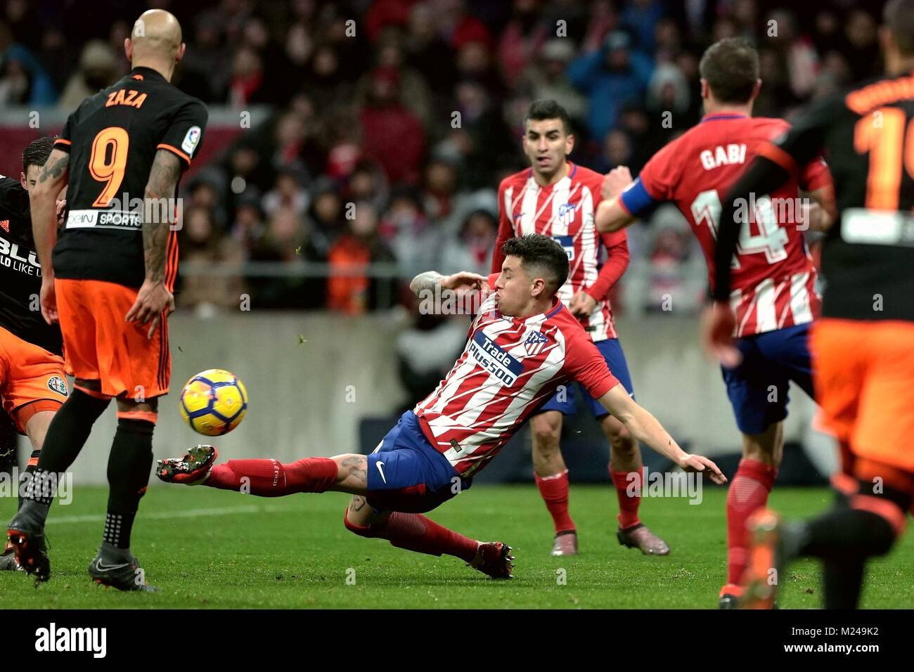 Madrid, Spain. 4th Feb, 2018. Atletico Madrid's Angel Correa (C) competes during a Spanish league match between - Stock Image